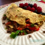 Breakfast: Pepper and leftover mexi seasoned ground beef omelet with berries